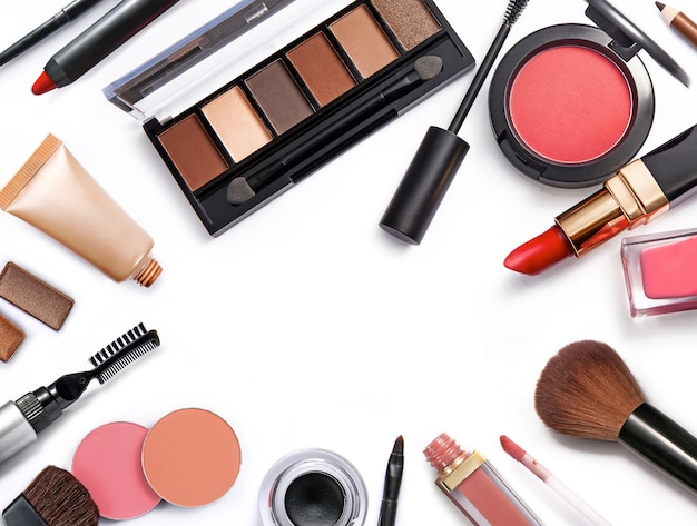 Top view of different cosmetics with copy space on white background