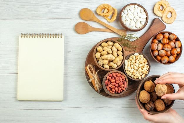 Top view different fresh nuts peanuts hazelnuts and walnuts