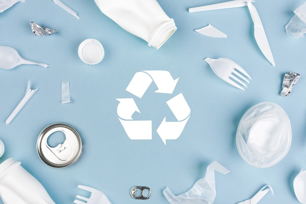 Top view of different garbage materials with recycling symbol. recycle, world environment day and eco concept