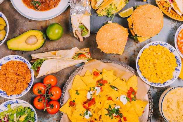 Top view of different mexican dishes on old weathered background