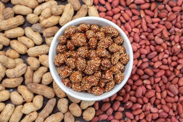 Top view different nut composition peanuts and sweet nuts color nut composition photo