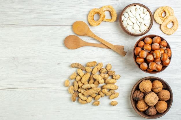 Top view different nuts peanuts hazelnuts and walnuts