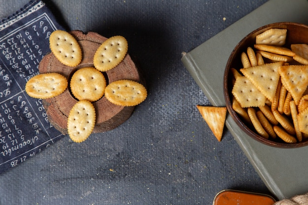 Top view different salted crackers on the grey background crisp snack photo cracker
