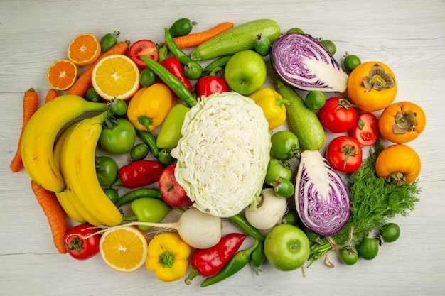Top view different vegetables with fresh fruits on light white background salad food health color  ripe diet