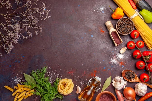Top view different vegetables with seasonings on a dark background salad health meal food