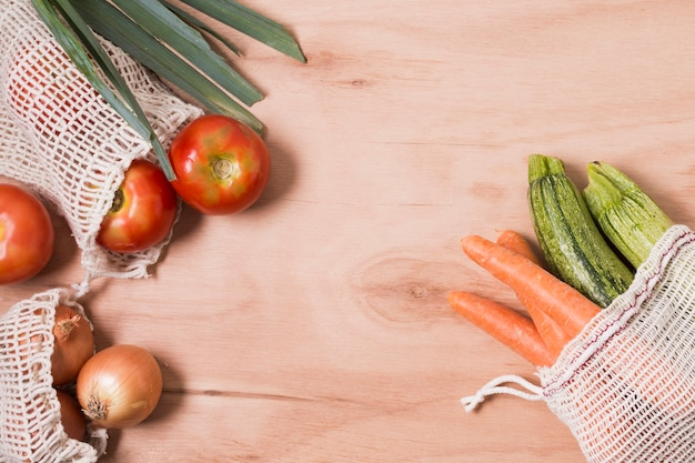 Top view different vegetables on wooden background with copy space