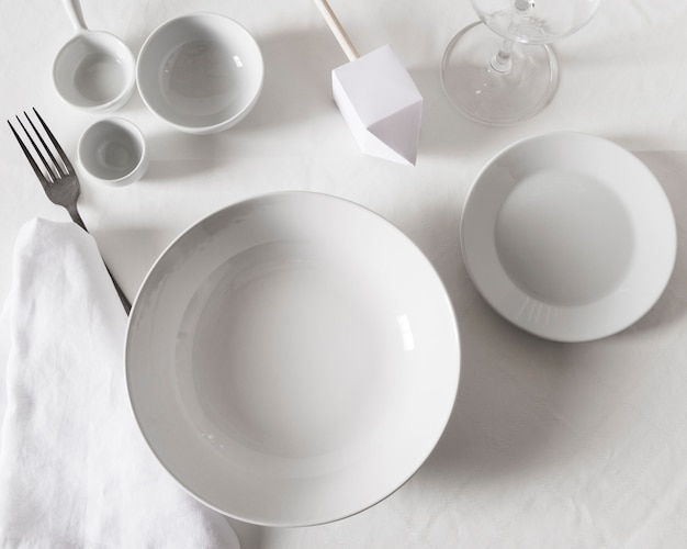 Top view of dinner table setting for hanukkah with multiple plates
