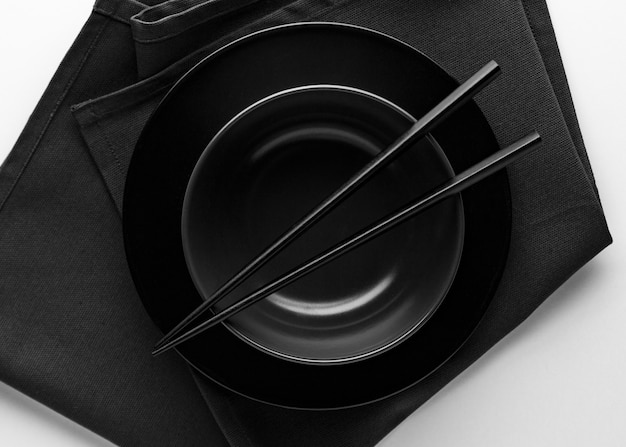 Top view of dinnerware with chopsticks