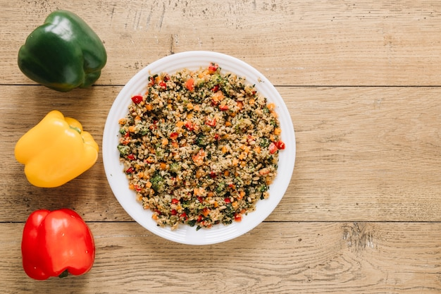 Top view of dishes with colorful bell peppers and copy space