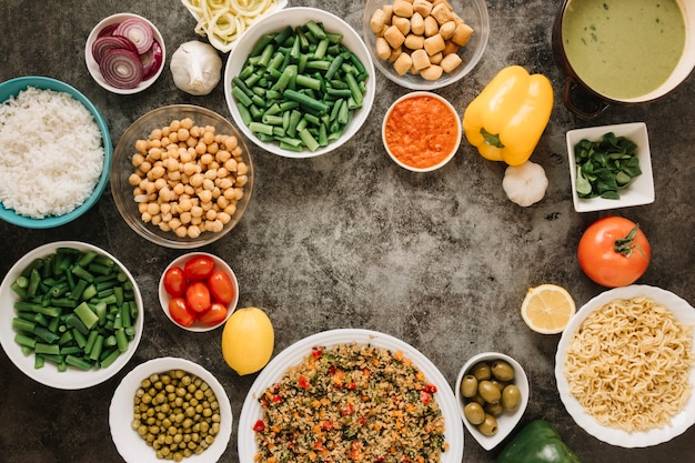 Top view of dishes with noodles and chickpeas
