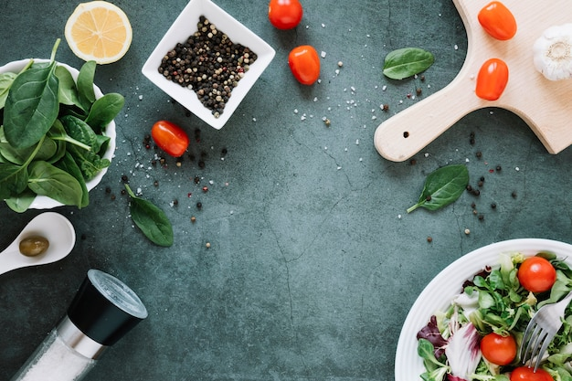 Top view of dishes with pepper and cherry tomatoes with copy space