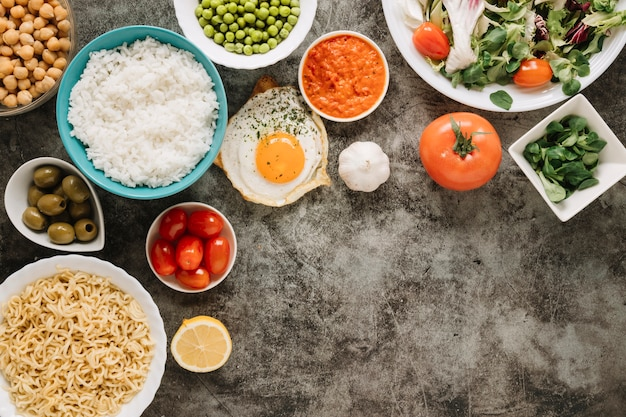 Top view of dishes with rice and tomatoes