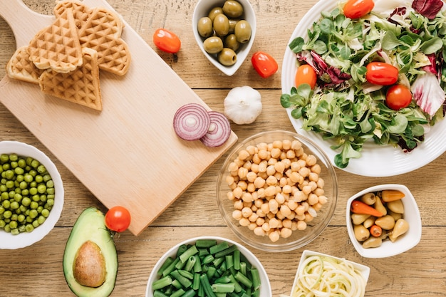 Top view of dishes with waffles and salad