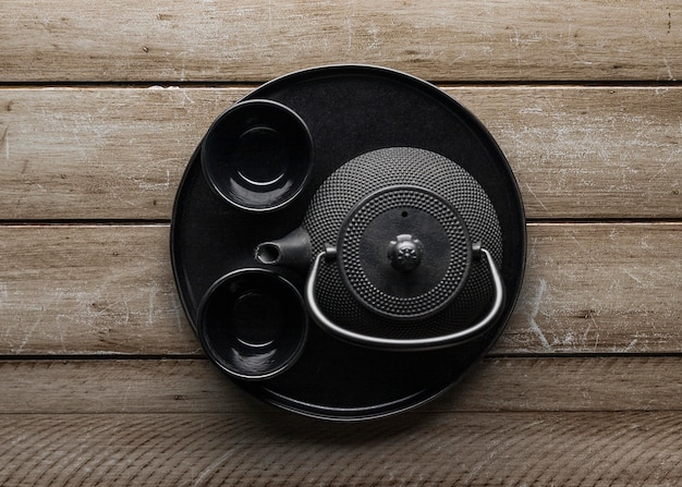 Top view of dishware with bowls and teapot
