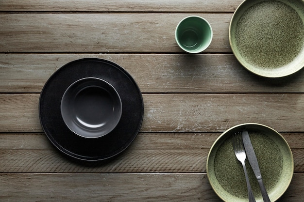 Top view of dishware with cutlery