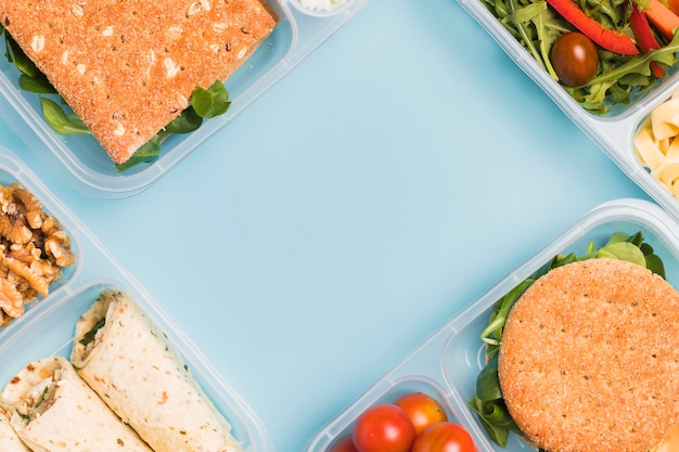 Top view diverse lunchboxes with copy-space