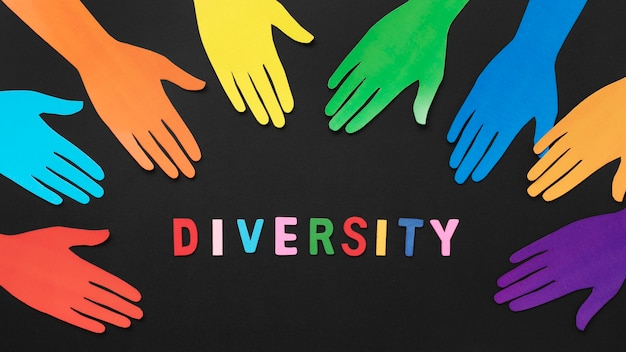 Top view diversity composition with different colored paper hands