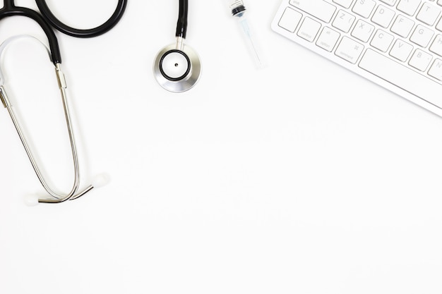 Top view of doctor's desk table with blank paper on white background,