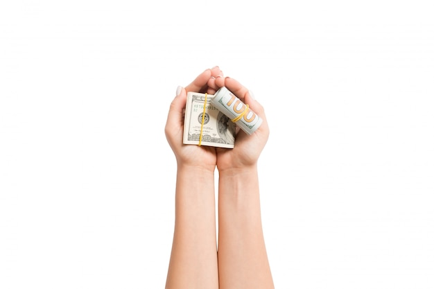 Top view of dollar banknotes in female hands