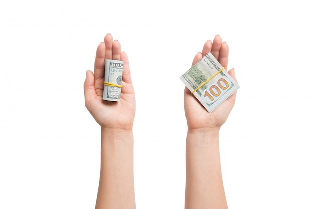 Top view of dollar bills in tubes in female hands on white
