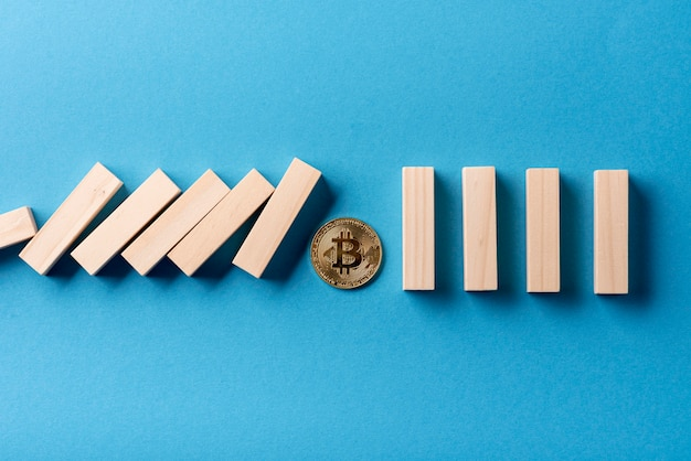 Top view of domino pieces and bitcoin
