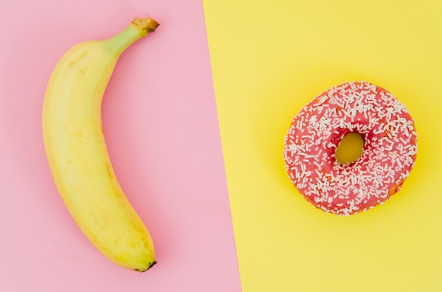 Top view donut vs fruit