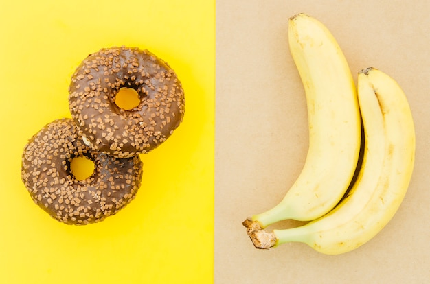 Top view donut vs fruit