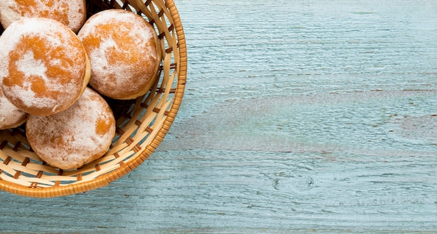 Top view of donuts in basket with copy space