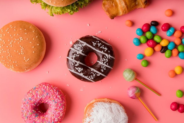 Top view donuts, burgers and sweets