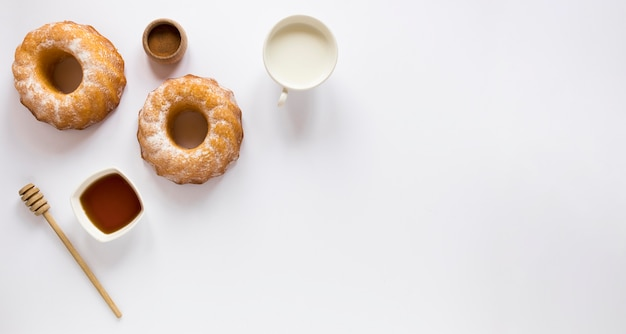 Top view of donuts with copy space and milk
