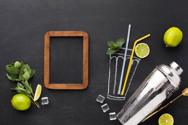 Top view of drawn cocktail glass with straws and blackboard