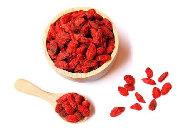 Top view of dried goji berries in wooden bowl