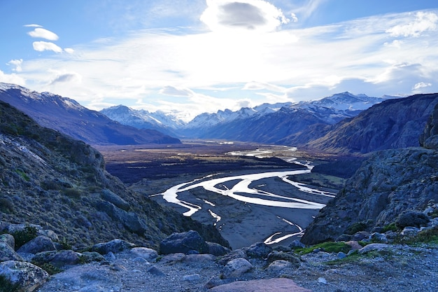 The top view of dried land with curving river at patagonia.