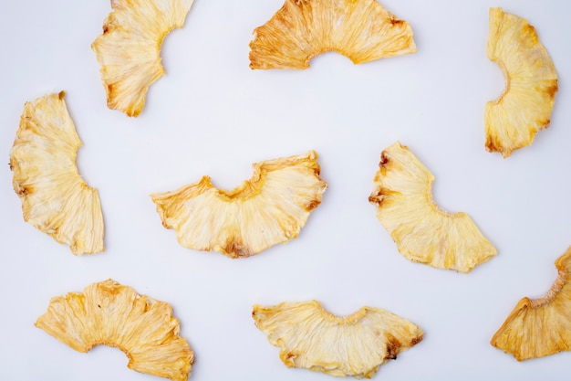 Top view of dried pineapple slices isolated on white background