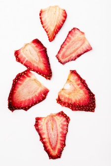 Top view of dried strawberry slices isolated on white background