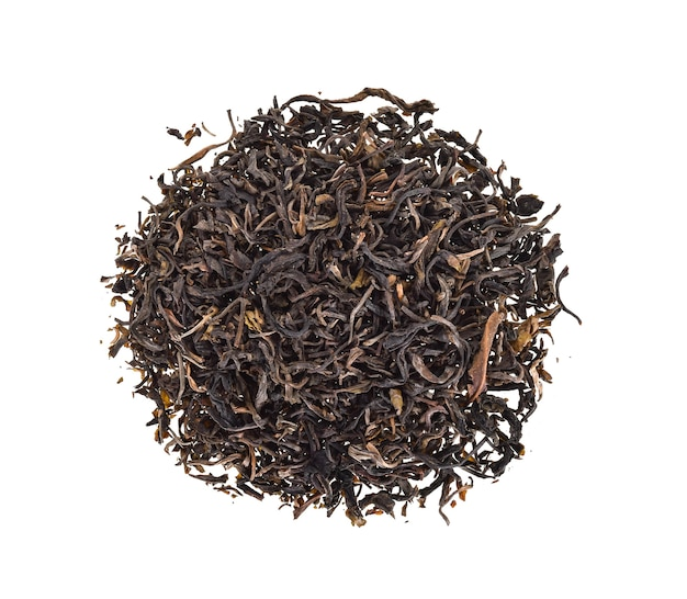 Top view of dried tea leaves on a white background.