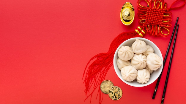 Top view of dumplings and pendant chinese new year