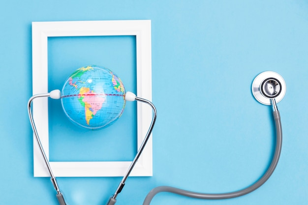 Top view of earth globe in frame with stethoscope