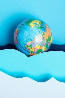 Top view of earth globe with paper ocean waves