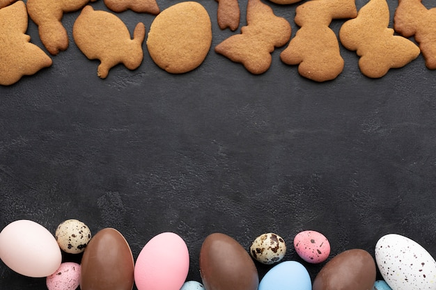 Top view of easter cookies with chocolate eggs