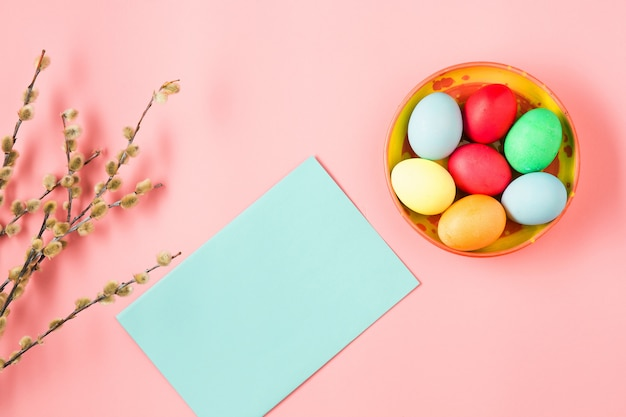Top view of easter eggs and blank greeting card