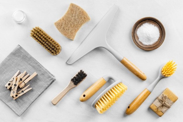 Top view of eco cleaning products with brushes