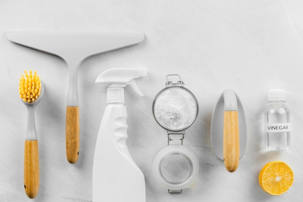 Top view of eco cleaning products with lemon and baking soda