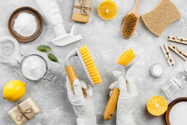 Top view of eco-friendly cleaning products with brushes and lemon