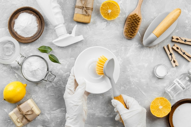 Top view of eco-friendly cleaning products with lemon and baking soda