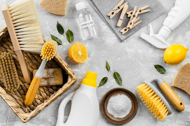 Top view of eco-friendly cleaning products with lemon