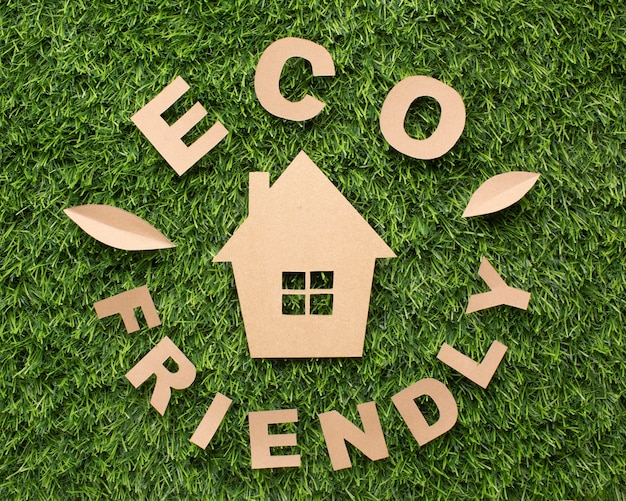 Top view eco friendly sign with miniature house