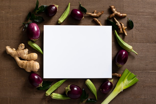 Top view eggplants and ginger with blank rectangle