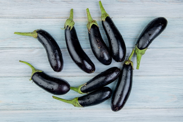 Top view of eggplants on wooden background