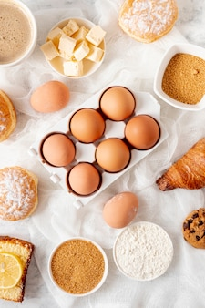 Top view eggs and dough ingredients